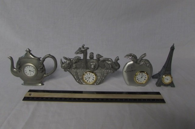 4 MINI NOVELTY DESK CLOCKS TALLEST ONE IS 4 1/2 INCHES,