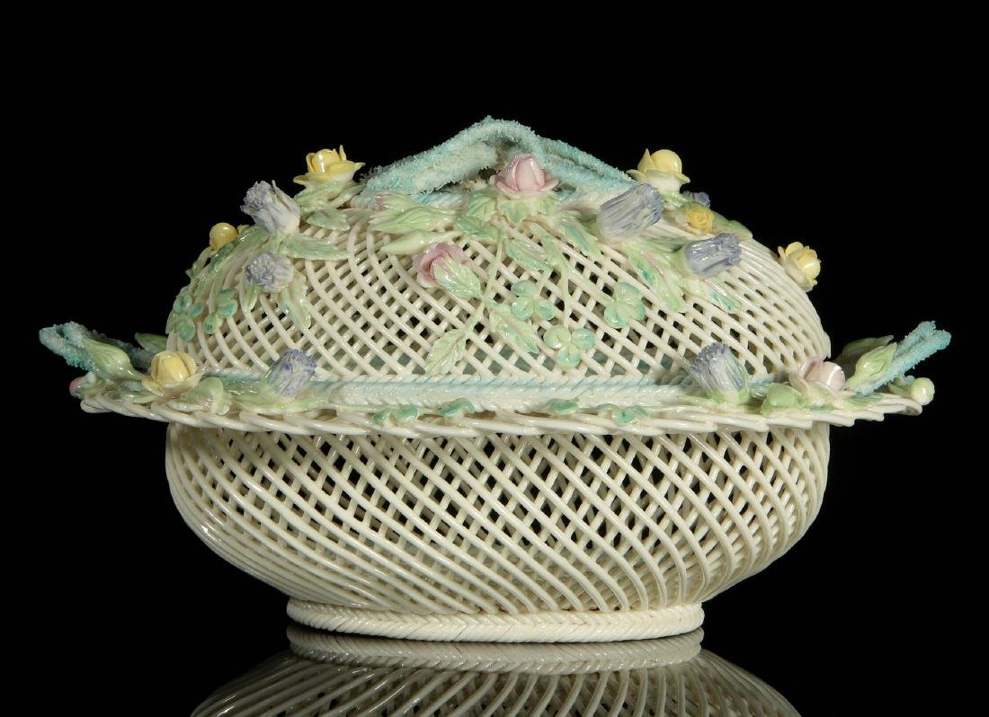 AN IRISH BELLEEK OVAL FOUR STRAND COVERED BASKET