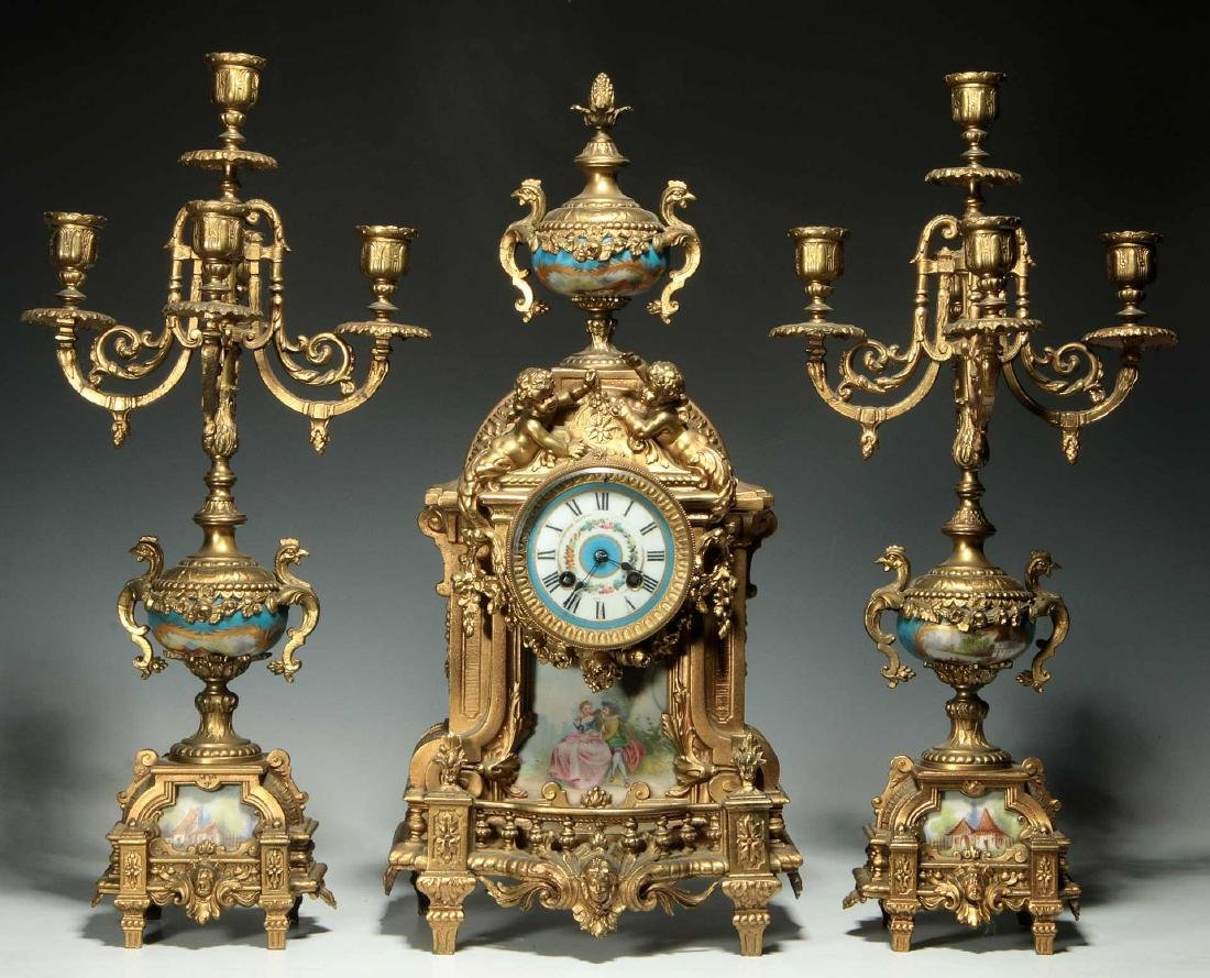 A THREE-PIECE FRENCH SPELTER CLOCK SET