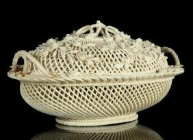 AN IRISH BELLEEK LARGE COVERED BASKET