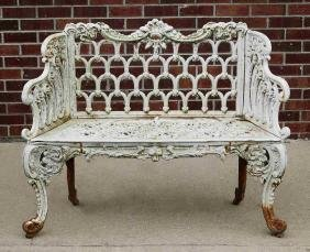 A 'WHITE HOUSE ROSE GARDEN' PATTERN IRON BENCH