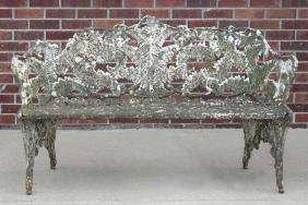 A VICTORIAN CAST IRON FERN PATTERN GARDEN BENCH