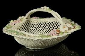 AN IRISH BELLEEK HENSHALL FOUR STRAND BASKET