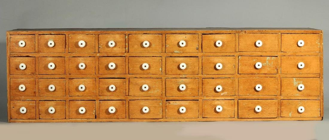 AN INTERESTING 19THC GRAIN PAINTED CASE OF DRAWERS