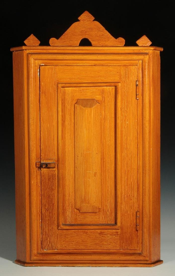 A 19C. COMBED GRAIN PAINTED HANGING CORNER CABINET