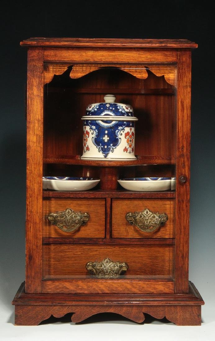 A SMALL UNUSUAL C. 1900 OAK SHAVE OR OTHER CABINET