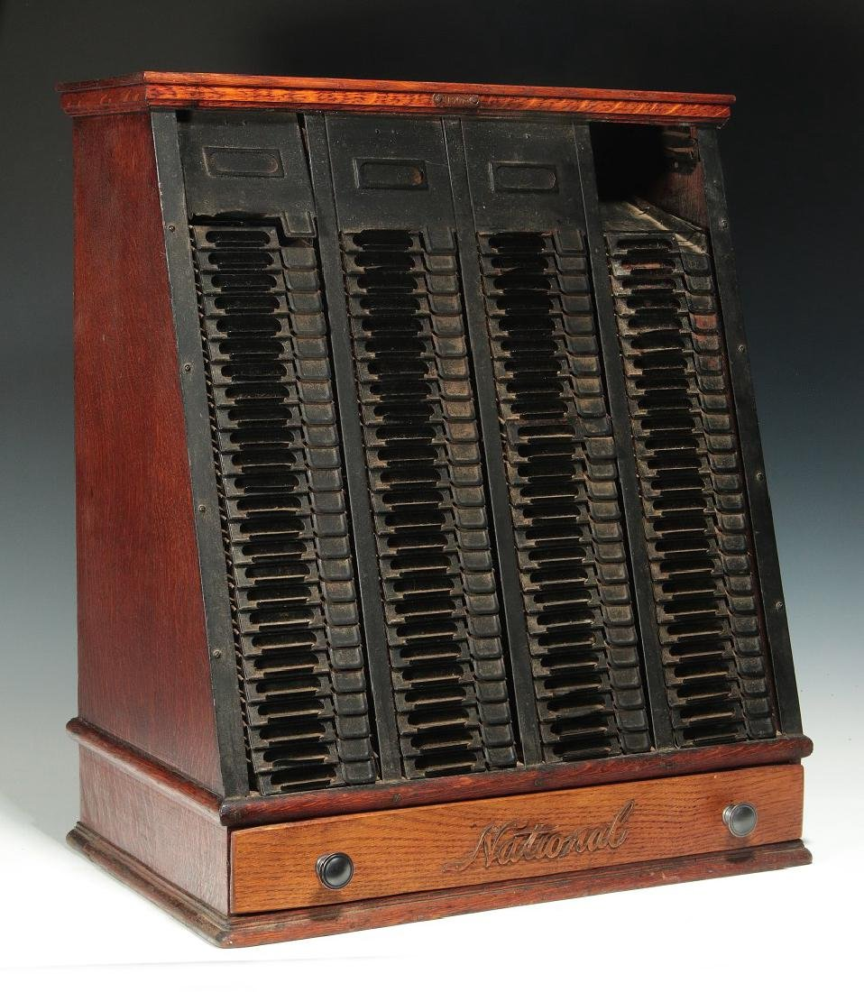 A 'NATIONAL' C. 1900 OAK AND STEEL TICKET CABINET