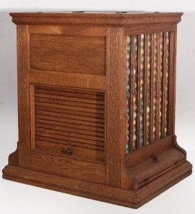 C 1890 OAK SPOOL CABINET WITH ROLL SIDES AND GLASS