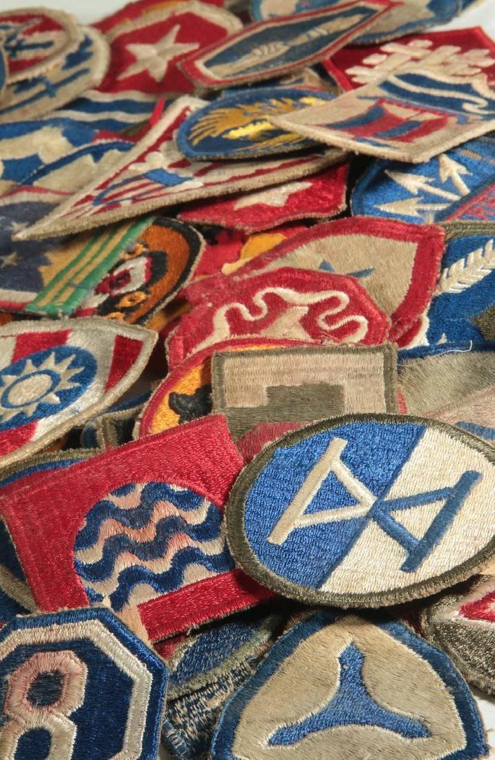 A COLLECTION OF 105 WWII-ERA US ARMY PATCHES