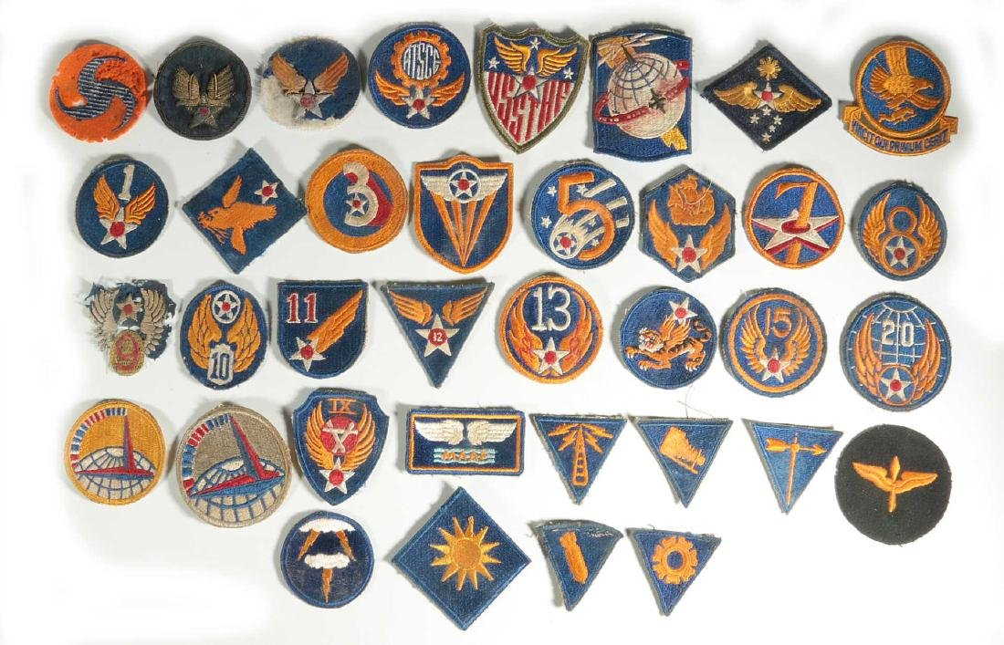 A COLLECTION OF 36 ARMY AIR FORCE AAF WWII INSIGN