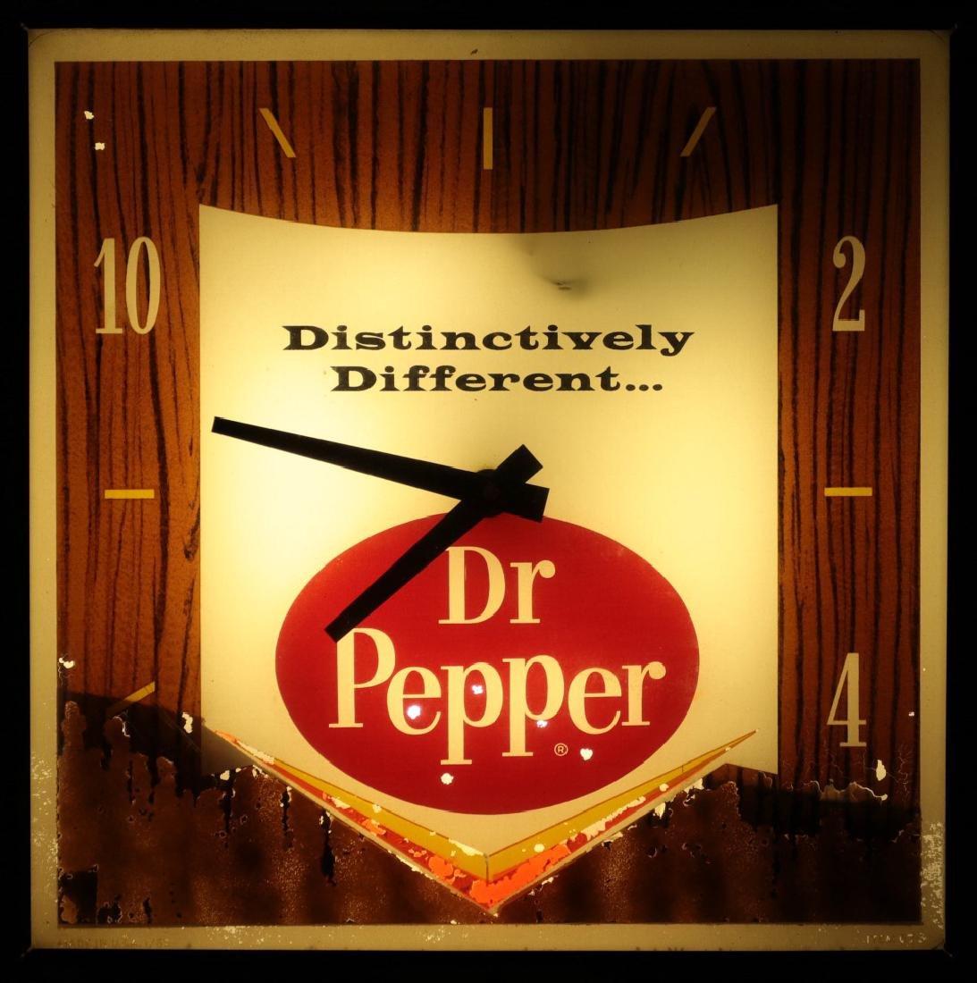 A VINTAGE LIGHTED DR. PEPPER ADVERTISING CLOCK