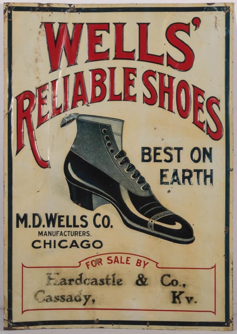 AN EARLY 20THC. EMBOSSED TIN SIGN FOR WELLS' SHOES