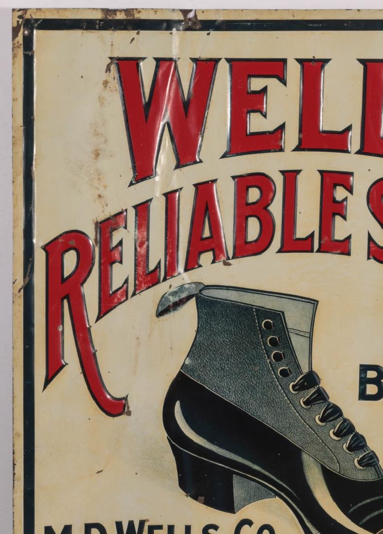AN EARLY 20THC. EMBOSSED TIN SIGN FOR WELLS' SHOES - 2