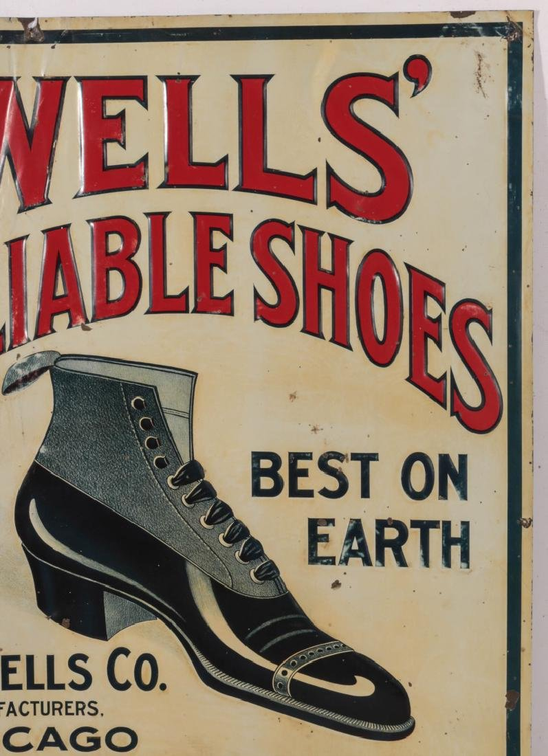 AN EARLY 20THC. EMBOSSED TIN SIGN FOR WELLS' SHOES - 3
