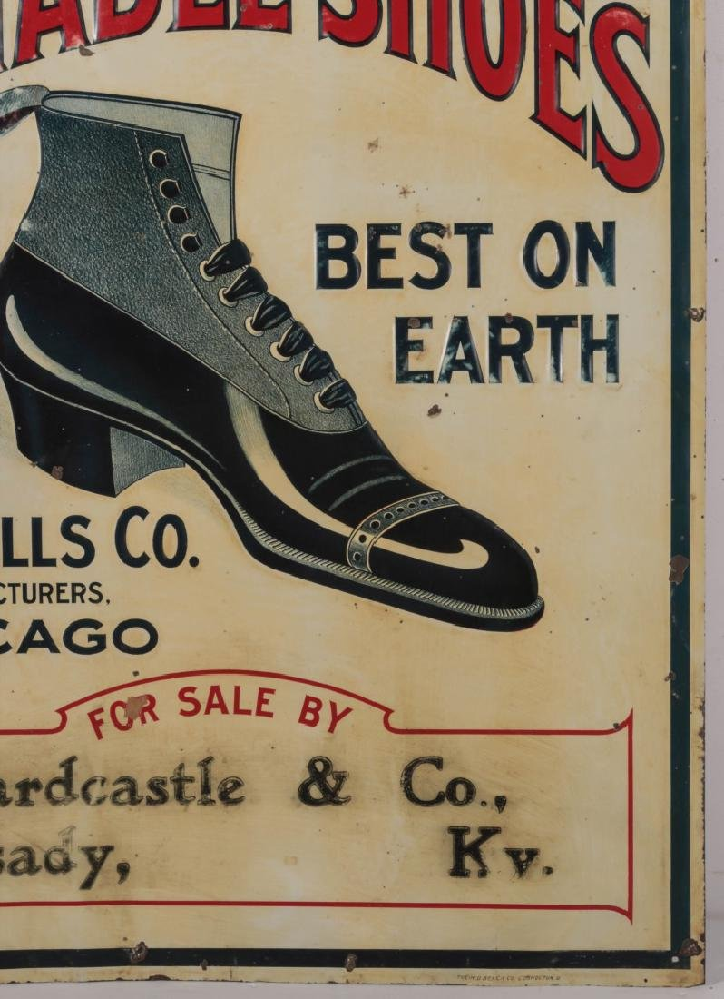 AN EARLY 20THC. EMBOSSED TIN SIGN FOR WELLS' SHOES - 4