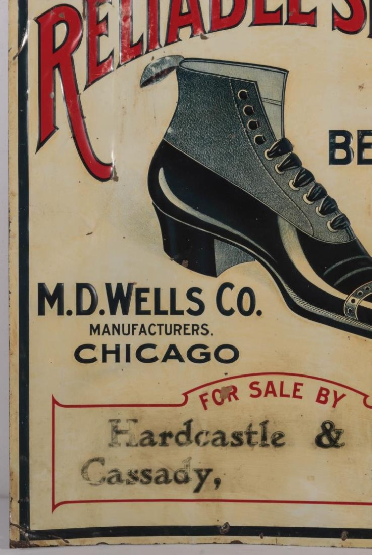 AN EARLY 20THC. EMBOSSED TIN SIGN FOR WELLS' SHOES - 5