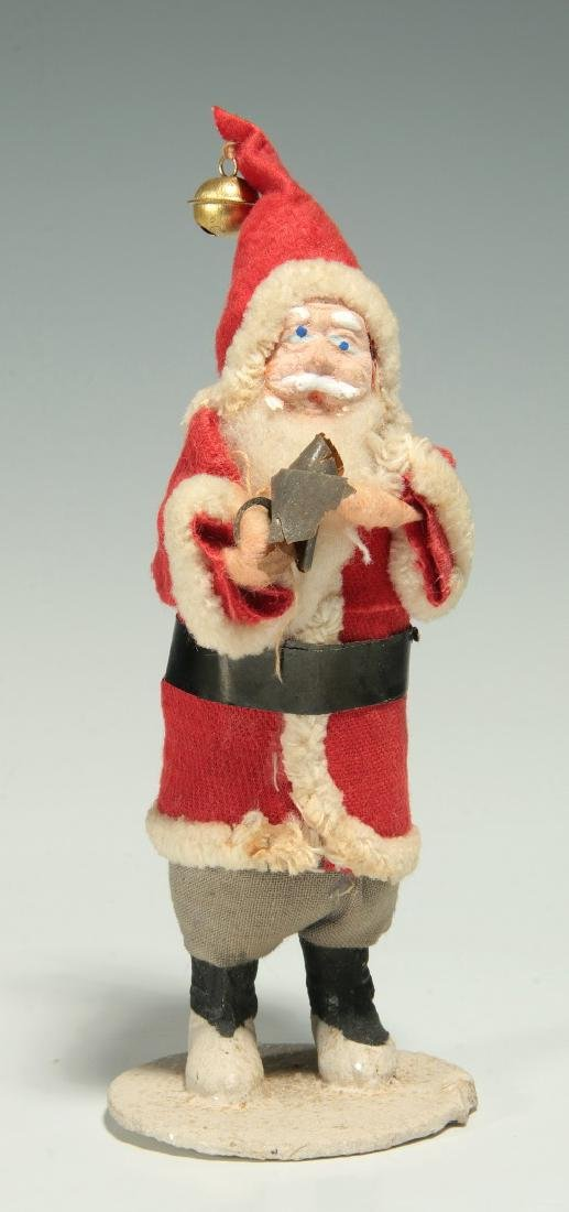 A VINTAGE COMPOSITION FACE SANTA CLAUS FIGURE