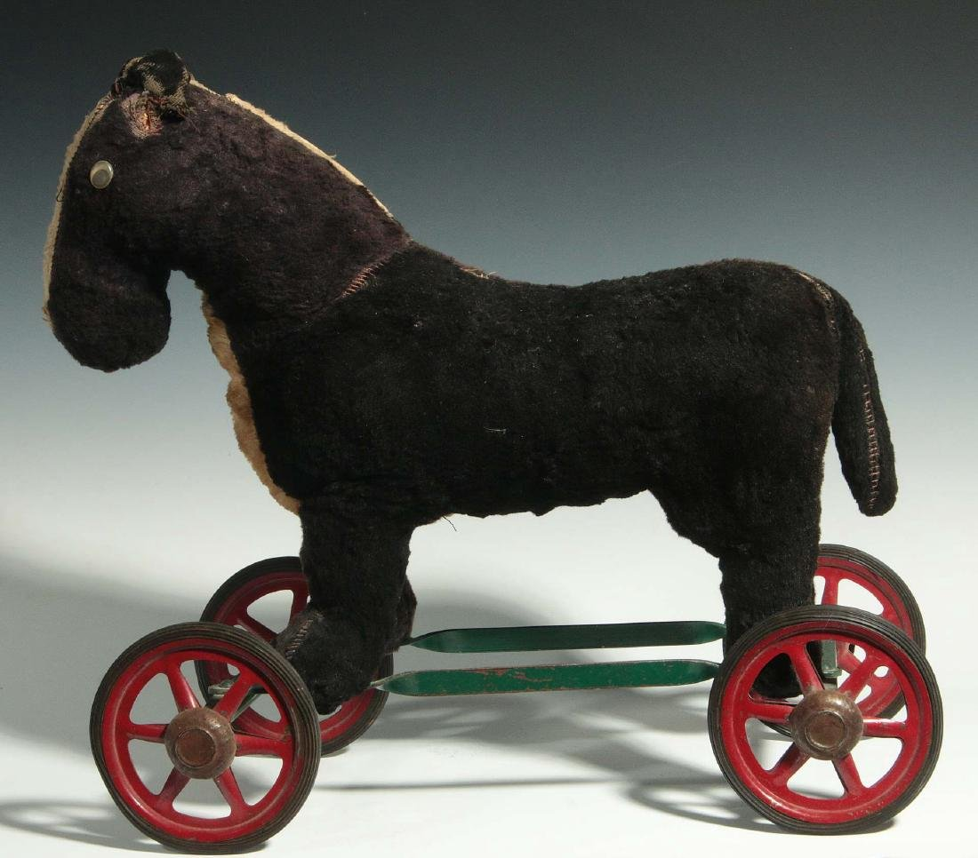 A VINTAGE PLUSH ANIMAL PULL TOY ON WHEELS - 8