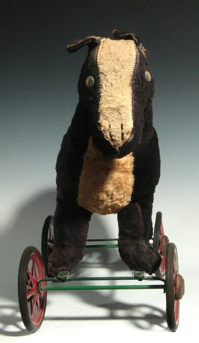 A VINTAGE PLUSH ANIMAL PULL TOY ON WHEELS - 9