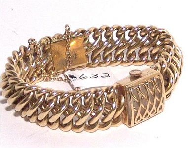 632: LADIES ROLEX 18KT. GOLD WATCH AND BAND