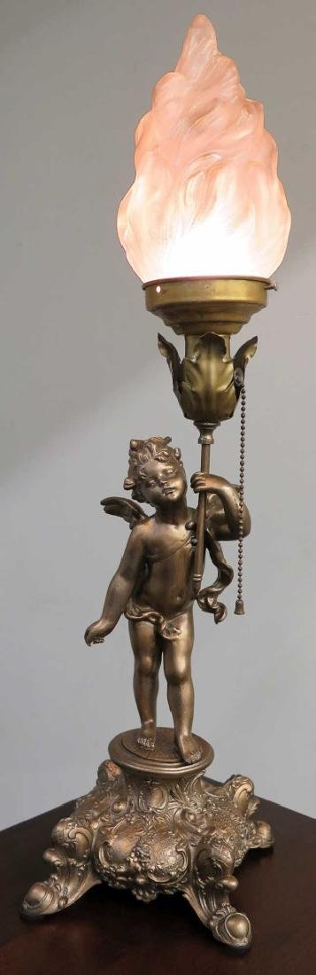 A CUPID FIGURAL BOUDOIR LAMP WITH TORCH SHADE