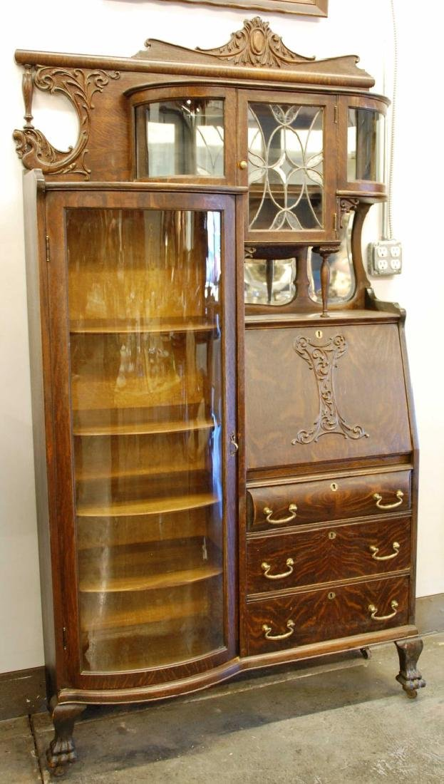 OAK WINGED GRIFFIN SECRETARY BOOKCASE WITH CURIO