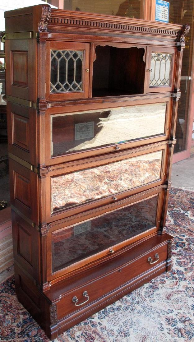 A RARE STACK BOOKCASE WITH CUBBY BETWEEN LEADED GLASS
