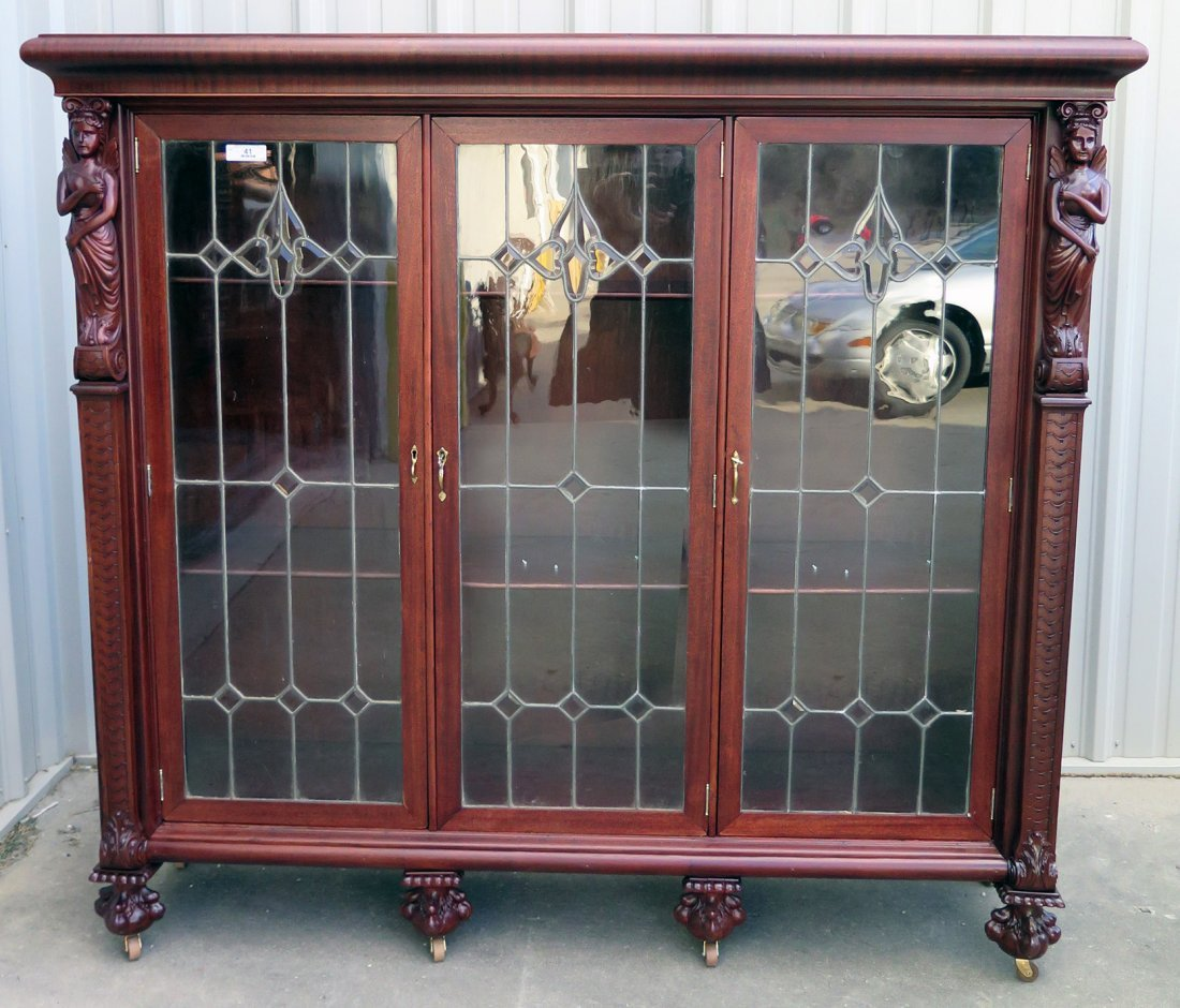 A MAHOGANY WINGED LADY BOOKCASE WITH LEADED GLASS DOORS