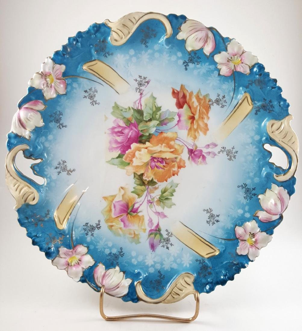 TWO RS PRUSSIA HANDLED FLORAL PLATES