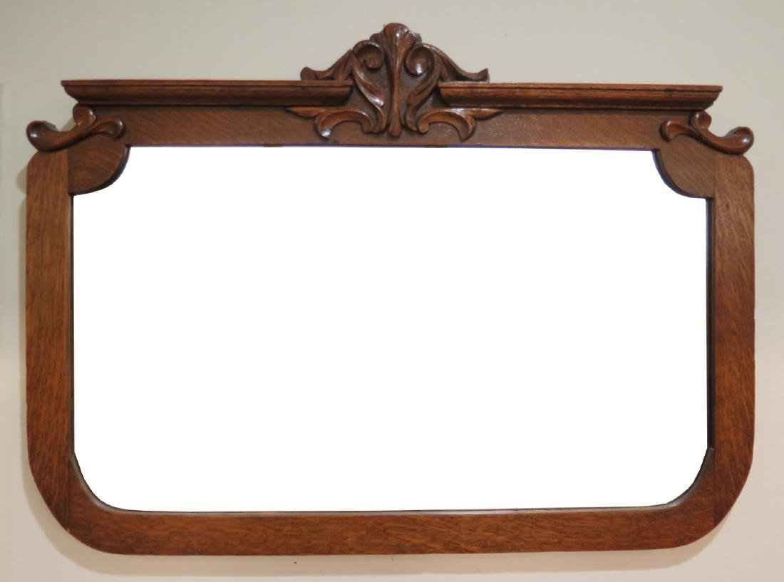 AN ANTIQUE OAK MIRROR