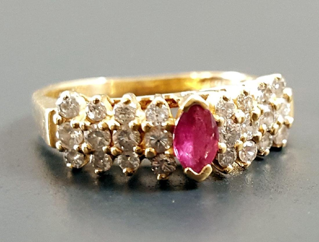 A 14K GOLD LADIES RUBY AND WHITE SAPPHIRE RING