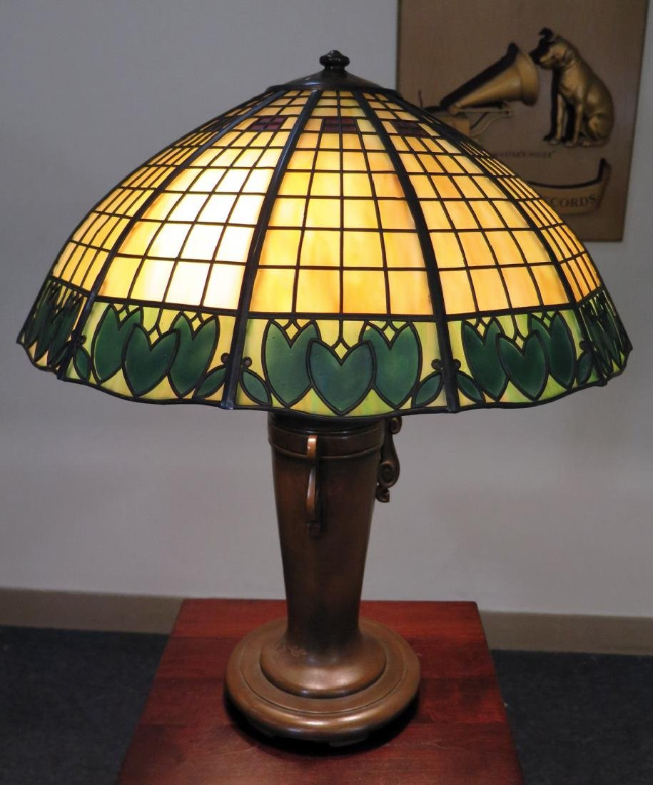 A HANDEL BRONZE AND GREEN GLASS TEROCA LINE TABLE LAMP
