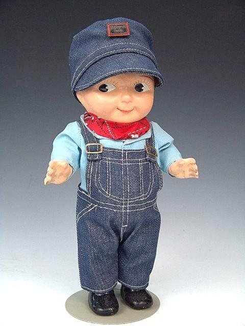 12: COMPOSITION BUDDY LEE DOLL