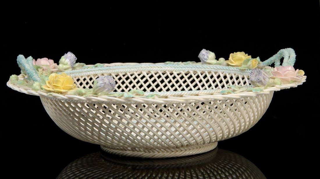 AN IRISH BELLEEK FOUR STRAND CIRCULAR BASKET - 10