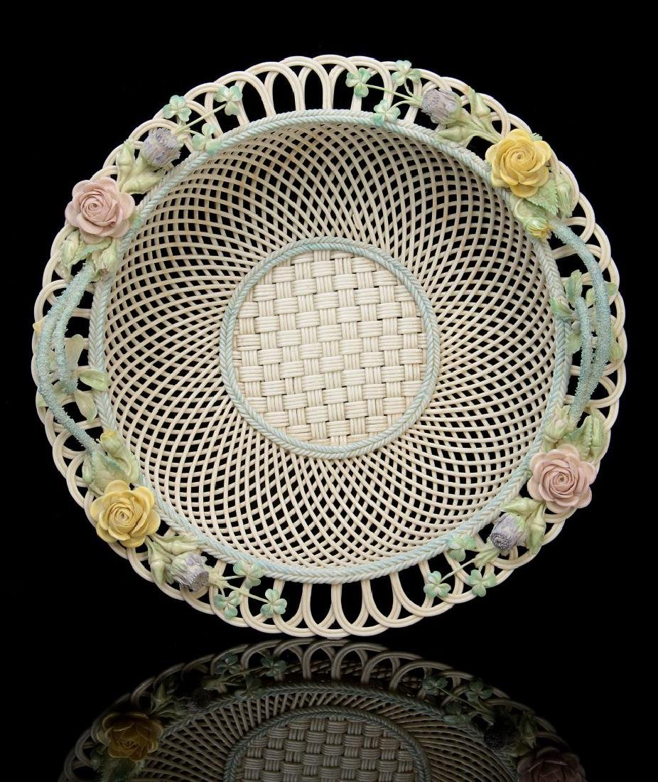 AN IRISH BELLEEK FOUR STRAND CIRCULAR BASKET