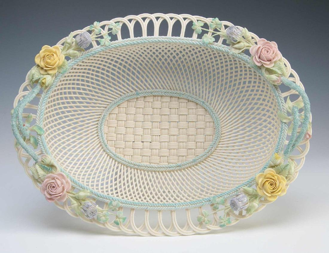 AN IRISH BELLEEK FOUR STRAND OVAL BASKET