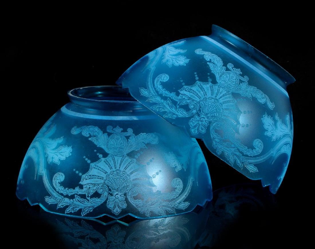 A PAIR 19TH C. FROSTED ETCHED BLUE GLASS LIGHT SHADES