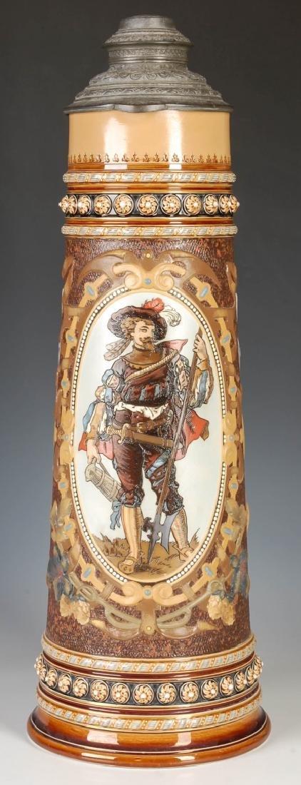 AN IMPRESSIVE 21-INCH METTLACH ETCHED STEIN #1498