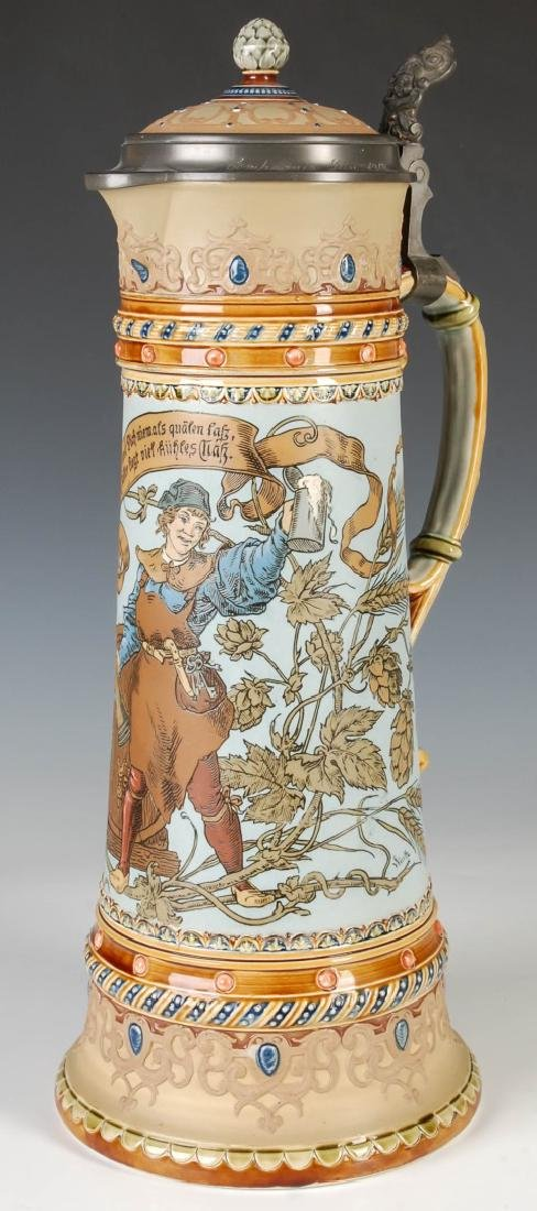 A 17-INCH METTLACH ETCHED AND JEWELED STEIN #1940