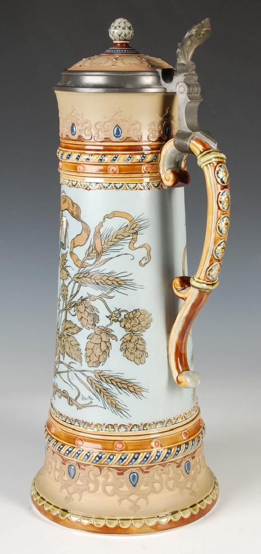 A 17-INCH METTLACH ETCHED AND JEWELED STEIN #1940 - 4