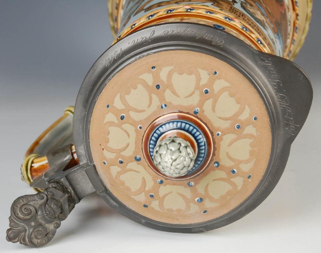 A 17-INCH METTLACH ETCHED AND JEWELED STEIN #1940 - 8