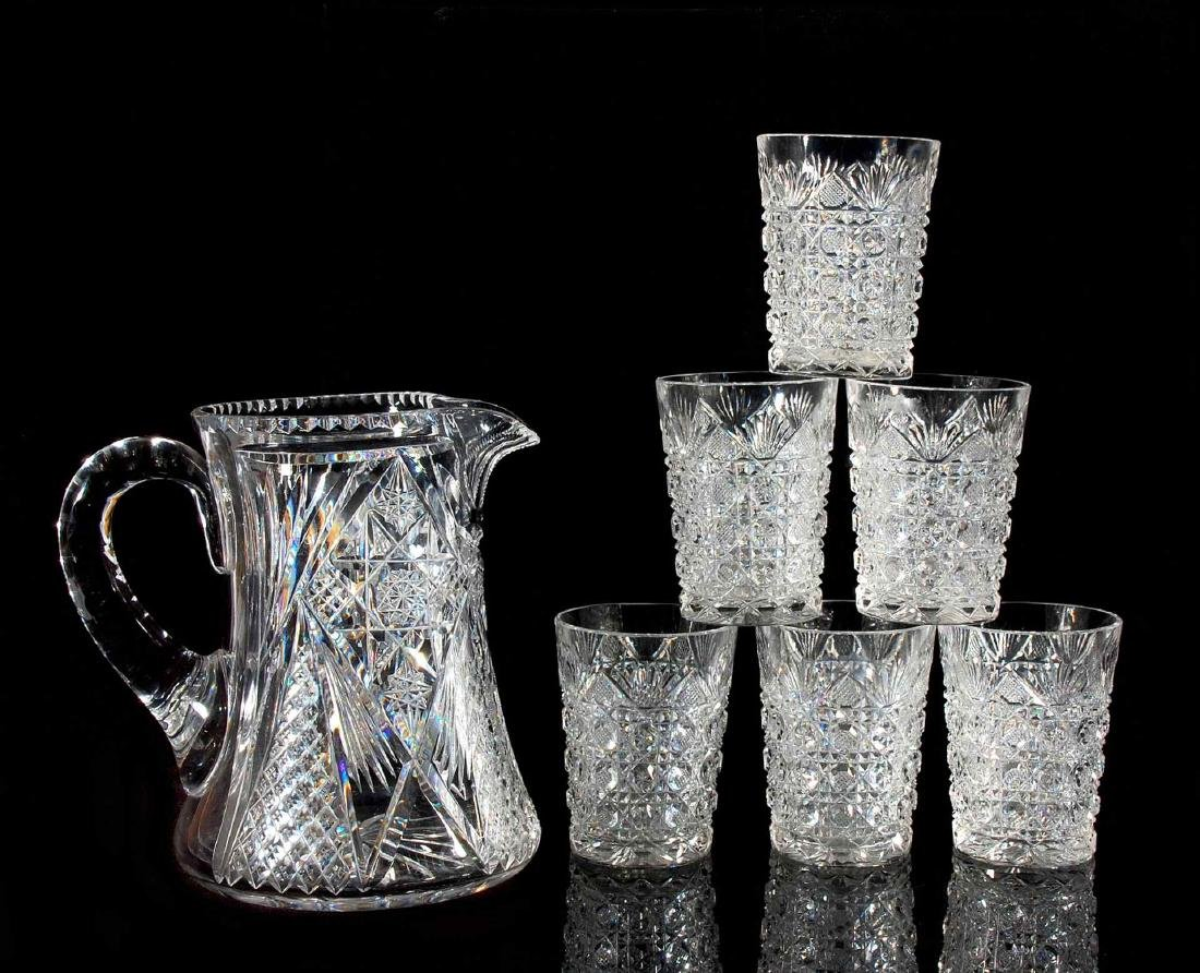 AN ABP CUT GLASS WATER SET PITCHER AND SIX TUMBLERS