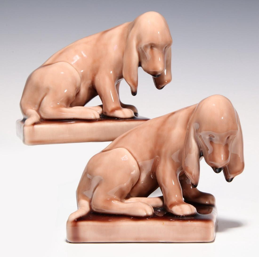 A PAIR OF ROOKWOOD ART POTTERY DOG BOOKENDS