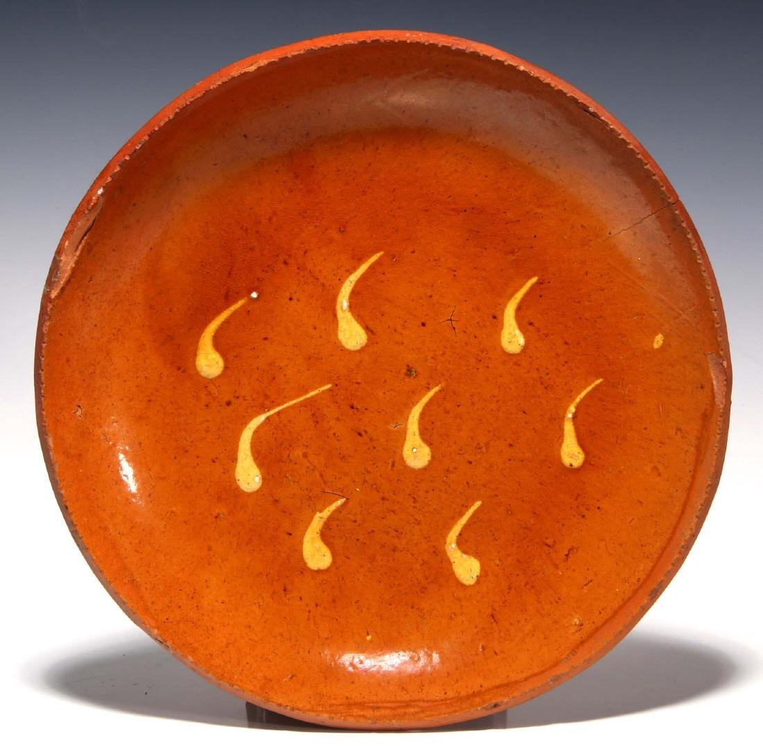 A SLIP DECORATED 19TH CENTURY REDWARE PLATE