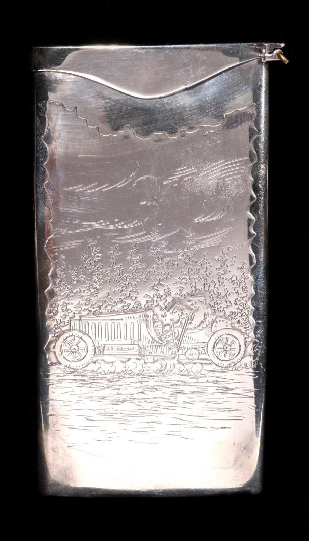 AN EARLY 20TH C. STERLING CASE WITH EARLY AUTOMOBILE