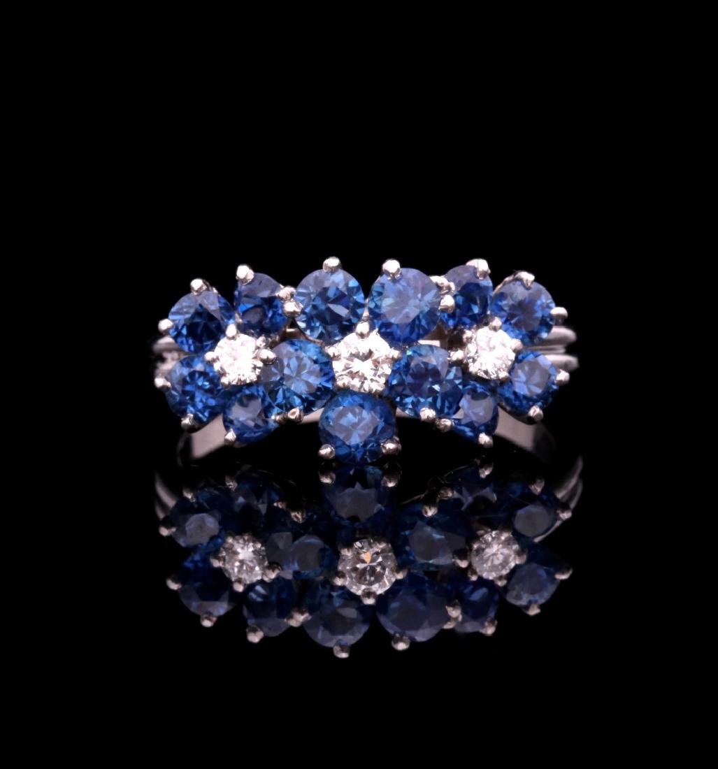 A DIAMOND AND PLATINUM FASHION RING WITH BLUE GEMS