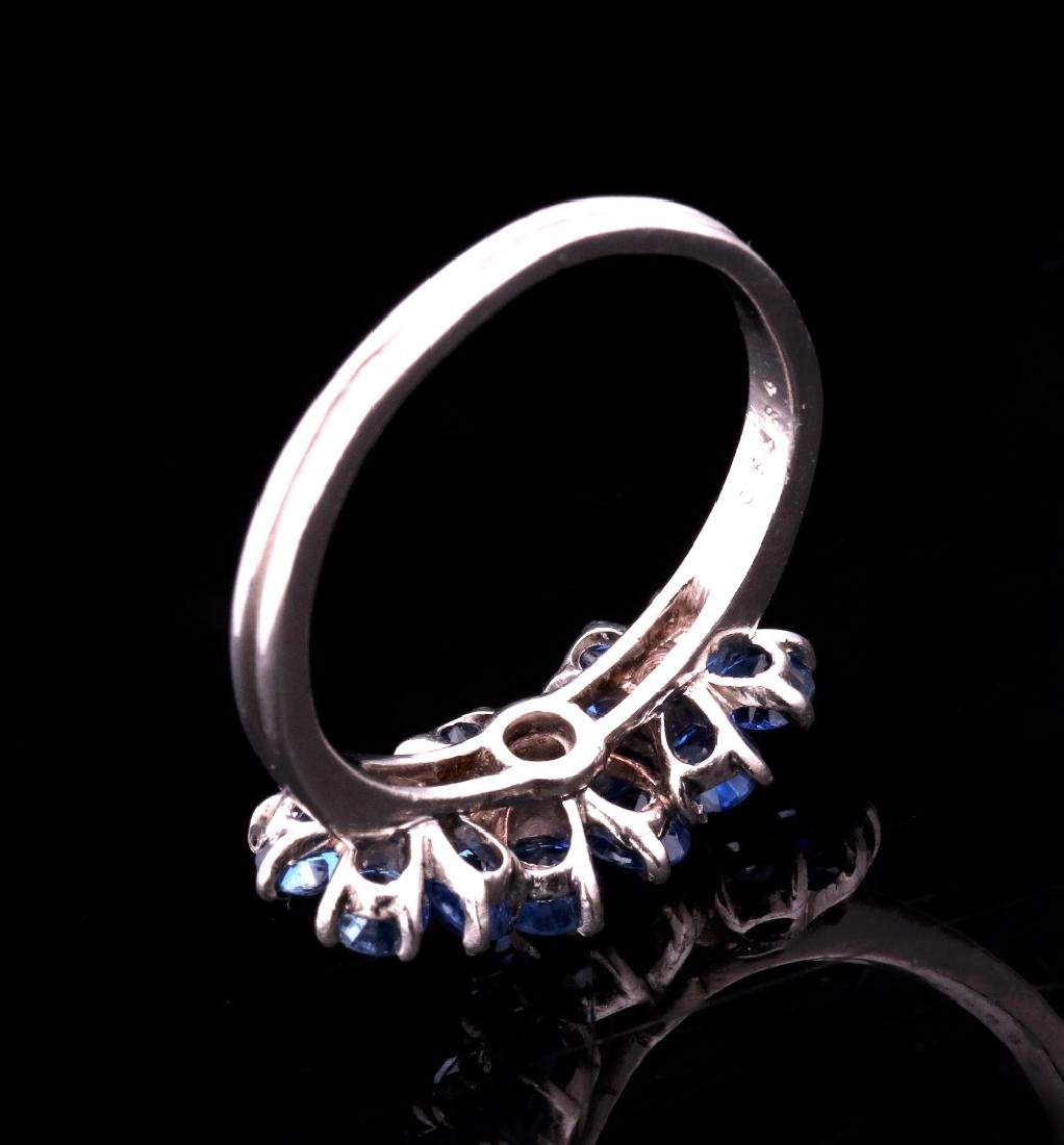A DIAMOND AND PLATINUM FASHION RING WITH BLUE GEMS - 8