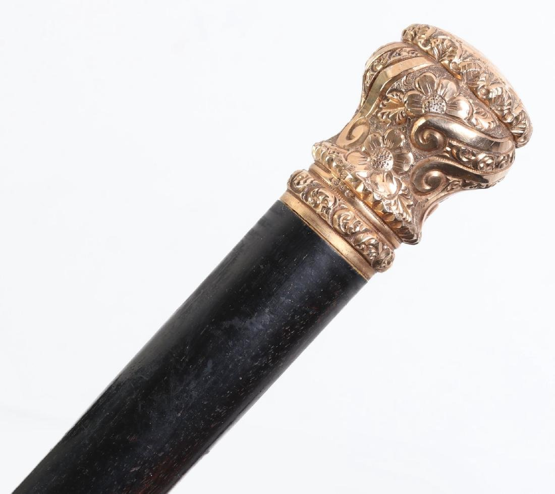 A SIMONS BROTHERS GOLD-FILLED CROWN WALKING STICK, 1902 - 2