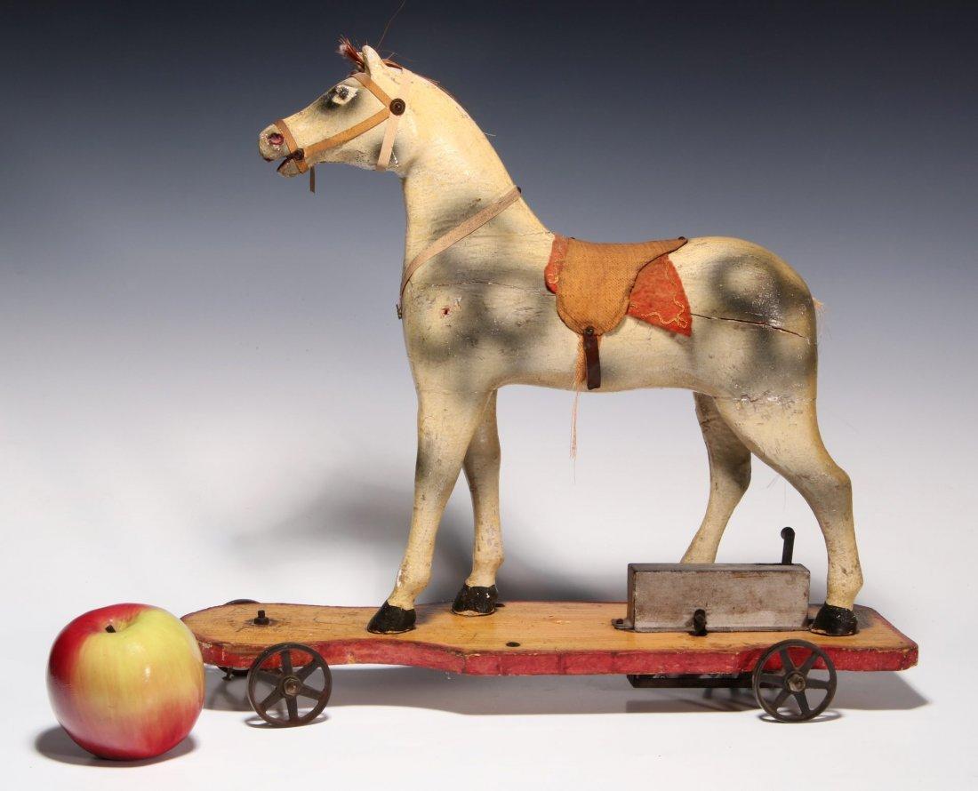 AN UNUSUAL 19TH C. KEY WIND PLATFORM HORSE ON WHEELS - 2