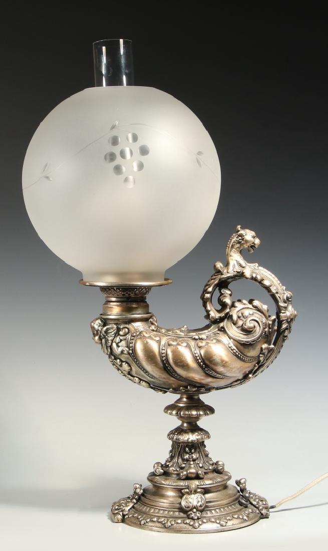 A CIRCA 1900 SILVERED GRIFFIN HARVARD LAMP